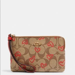 Coach Bags - ❌Sold❌🔥Corner Zip Wristlet With Hearts Print